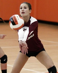 Naugatuck's Ashley Whitney digs the ball during a volleyball matchup against Terryville Thursday night in Terryville. The Greyhounds topped Terryville 3-0 for their tenth straight win.-RA ARCHIVE