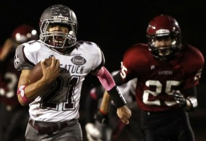 Naugatuck's Nate Franklin brings the ball up field during their NVL matchup against Torrington Oct. 11. The Greyhounds won the game, 33-3. –RA ARCHIVE