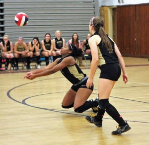 Woodland's Ashley Michie (5) digs the ball in front of teammate Jillian Gorman (2) Oct. 10 versus the Greyhounds in Naugatuck. The Hawks lost the game, 3-1, but still control their destiny for the Brass Division title. –ELIO GUGLIOTTI