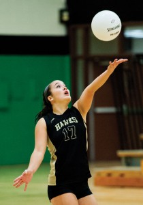 Woodland's Samantha Lee serves Tuesday during the NVL semifinals versus Wolcott at Wilby High School in Waterbury. Woodland swept Wolcott, 3-0, to advance to the title game. –RA ARCHIVE