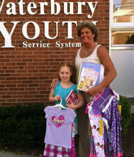 Grace Ann, of Beacon Falls, recently turned 8 years old and instead of birthday presents asked her friends for new pairs of pajamas and books to donate to the Pajama Project, a non-profit organization that distributes new pajamas books to children living in SAFE homes, group homes and foster care. Grace recently delivered her donation to Waterbury Youth Services Executive Director Kelly Cronin. -CONTRIBUTED