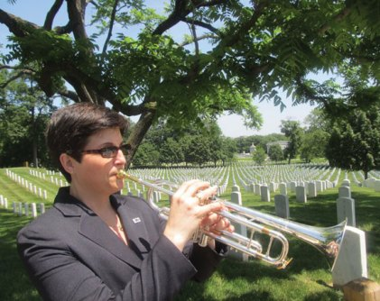 Lisa Pettinicchi, an Oakville resident and the band teacher at Cross Street and Hillside intermediate schools in Naugatuck, will perform Taps with over 100 buglers from throughout the country Nov. 16 at Arlington National Cemetery during the ceremony marking the 50th anniversary of the funeral of former President John F. Kennedy. –CONTRIBUTED