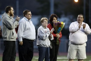 Dorothy Mariano, center, and family members were recognized before Naugatuck's home opener Sept. 20. The season was dedicated to Mariano's late husband, Ed Mariano, a borough icon who passed away in August. –RA ARCHIVE