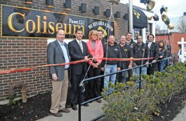 Naugatuck Mayor Robert Mezzo, second from left, surrounded by local dignitaries, members of the public and Coliseum Pawn employees cuts a ribbon to signify the official opening of the pawn shop at 59 Rubber Ave. Nov. 22. The pawn shop has been open for approximately seven weeks, owner Glenn Spector said. Spector owns the shop with three other partners, Dave Pires, Nick Dadonna and Alfredo Viscariello. Pires, Dadonna, and Viscariello also own Coliseum Trading Post in Torrington.–LUKE MARSHALL