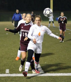 Naugatuck's Kyla Magalhaes (19) and Watertown's Erin Montambault (4) battle for position Oct. 30 during the NVL tournament title game at Municipal Stadium in Waterbury. Watertown won the game 2-1 on penalty kicks (5-3). The Greyhounds bounced back Monday with a 1-0 win over Bristol Central during opening round of the Class L tournament at Naugatuck High School. -ELIO GUGLIOTTI