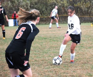 Woodland's Gillian Hotchkiss (16) tries to get the ball past Plainfield's Hannah Robillard (6) Nov. 6 during the second round of the Class M state tournament in Beacon Falls versus Plainfield. The Hawks rallied to beat Plainfield, 2-1, but couldn't repeat the feat Nov. 8 in the quarterfinals versus Weston. The Trojans defeated the Hawks, 2-1. –LUKE MARSHALL