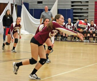 Naugatuck's Stefani Barry leans in to hit the ball Nov. 4 versus Bristol Central during the opening round of Class L volleyball tournament at Naugatuck High School. Bristol Central won the match, 3-1. –ELIO GUGLIOTTI
