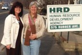 All About You Home Care Services in Naugatuck recently donated hand-knitted hats and scarves to the Human Resource Development Agency on Rubber Avenue in Naugatuck. Pictured, Veronica Rinaldi, All About You Home Care's community liaison, left, and Lynn Donovan of Human Resource Development Agency modeling a hat, scarf set. -CONTRIBUTED
