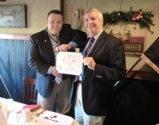 President of the Colonel Jeremiah Wadsworth Branch No. 7 of the Connecticut Society of the Sons of the American Revolution Chris Nichols, left, presents the Branch Flag Award for Patriotism to Prospect resident Bob Hiscox, founder of the Prospect Flag fund. Hiscox was recognized for his work in establishing the Prospect Flag Fund. The fund displays over 100 American Flags throughout Prospect honoring all past and current military members. Nichols, a Prospect resident and a U.S. Navy veteran of the Persian Gulf War, was especially appreciative to learn of the purpose for the flag fund. Hiscox received the Branch's flag award along with the state society's outstanding citizenship award during a regular business meeting of the branch recently held at J. Timothy's Tavern in Plainville. The Sons of the American Revolution is a made up of men who descend from documented patriots of the American Revolution. For more information, visit www.sar.org or email spshaw76@gmail.com. Donations to the flag fund can be sent directly to Prospect Town Hall, 36 Center St., Prospect, CT 06712. –CONTRIBUTED