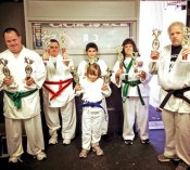 Seven members of the Special Needs Division from USA Martial Arts in Naugatuck performed well and took home gold at a competition Nov. 10 hosted by Cheezic Tang Soo Do at the Waterbury Athletic Center. The form was for board breaking and traditional forms. Pictured, from left, Joseph Grouse, Jimmy Leonetti, Hannah Durivage, Matthew Macchio, Michelle Bernardini and Chris Crane. Not pictured, Nate Peterkin. -CONTRIBUTED