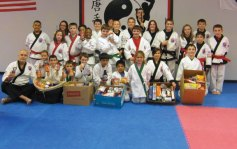 USA Martial Arts in Naugatuck recently sponsored a food drive to help the local food bank in the area stock its shelves in preparation for the holidays. Many local families supported the efforts and over 400 pounds of food was collected. –CONTRIBUTED