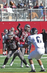 Naugatuck's Jason Bradley (13) throws a pass Thanksgiving morning versus Ansonia at Naugatuck High School. Ansonia beat Naugatuck, 66-28. -RA ARCHIVE