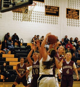 Naugatuck's Christina Jando goes for the block as Angelina Piccirillo (10) comes in to help on defense Monday night versus Kaynor Tech in Waterbury. The Greyhounds won the game, 58-22. –KEN MORSE