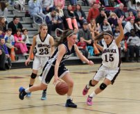Naugatuck's Taylor Campos (15) and Emma Colucci (23) make life difficult for Ansonia guard Morgan Westine (2) as she tries to bring the ball up court Dec. 20 at Naugatuck High. The Greyhounds beat the Chargers, 49-27. –ELIO GUGLIOTTI