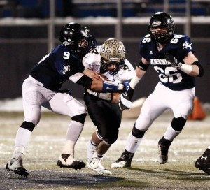 Woodland's Sean McAllen carries the ball as Ansonia's Laurence Carfaro makes the tackle during the Class S championship game Dec. 13 at Central Connecticut State University in New Britain. Ansonia won the game, 51-12. –RA ARCHIVE