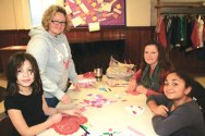 Naugatuck residents and members of Salem Lutheran Church, from left, Ciara Spears, Kelli Grzeika, Sharon Hurlbut and Alissa Grzeika participate in the 7th Annual Trumbull-Porter Chapter DAR Valentine workshop Jan. 11 at the church. Over 190 Valentine cards were made during the workshop that will be distributed to the veterans at the VA Hospitals in West Haven, Rocky Hill and Newington as part of the National Society Daughters of the American Revolution (NSDAR) Salute to Hospitalized Veterans. Over 50 pounds of candy was collected and then bagged to be given as favors for the veterans as well. Another 19 pounds of hard candy was donated to be shipped to active duty service men and women. –CONTRIBUTED