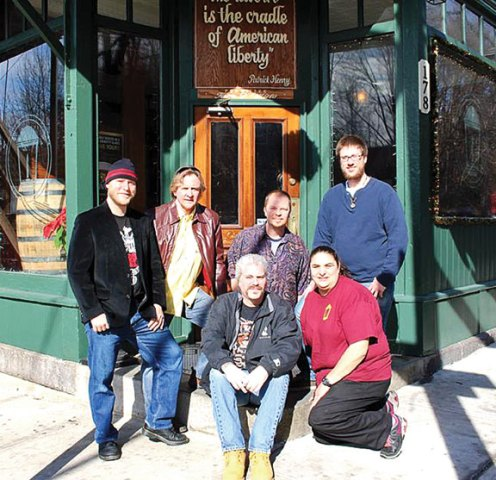 The band, The Remnants, (in back) will be playing a charity function for Jim Stotz, who was badly injured in a motorcycle accident, Feb. 14 from 9 p.m. to midnight at The Corner Tavern, 178 N. Main St. Donations will be accepted at the door. Stotz is sitting next to Tara Mirto, co-owner of The Corner Tavern. –CONTRIBUTED