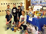 The Cross Street Intermediate School Student Council led a drive, its 'Souper Bowl,' to collect non-perishable items to benefit the Naugatuck Ecumenical Food Bank. Leading up to the Super Bowl Feb. 2, students and staff brought in food items and placed them in the collection area designated for their favorite team playing in the big game — the Denver Broncos or the Seattle Seahawks. It was the second time this school year the council led a food drive. A drive in the fall collected over $700 worth of food. Pictured, Cross Street students Sydney O'Donnell, Jay Mezzo, Ryan Maguire, Michael Marzano, James Montinola and Dante Miranda count the items collected during the 'Souper Bowl.' –CONTRIBUTED
