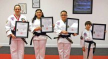 Sokol's Taekwondo students, from left, Valerie Fortney, Samantha Figueroa, Stunami Figueroa and Andrew Khairallah were promoted to the rank of 1st Degree Black Belt at a rank testing Oct. 26, 2013. –CONTRIBUTED