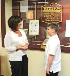 Hillside Intermediate School Principal Johnna Hunt talks with fifth-grader Zachary Setzer at the Naugatuck school Feb. 21. Hunt won the Connecticut Association of Schools 2014 Middle School Principal of the Year award. -LUKE MARSHALL