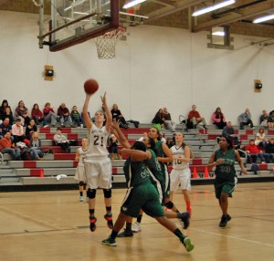 Naugatuck's Nicole Boucher (21) scores two of her 13 points Feb. 11 versus Wilby in Naugatuck. The Greyhounds defeated the Wildcats, 59-27, to earn their eighth win of the year and a trip to the state playoffs. –KEN MORSE