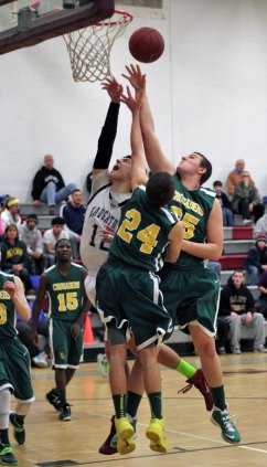 Naugatuck beat Holy Cross, 48-41, Feb. 21 and clinched a spot in the state tournament. –ELIO GUGLIOTTI