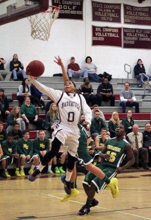 Naugatuck's Dayvon Russell (0) finishes off a fast break with a layup Feb. 21 in Naugatuck versus Holy Cross. The Greyhounds won the game, 48-41, and clinched a spot in the state tournament. –ELIO GUGLIOTTI