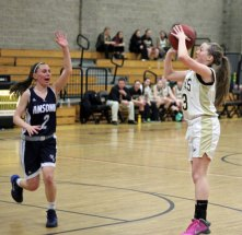 Woodland's Rebecca Hale, (3) shoots as Ansonia's Morgan Westine (2) runs in on defense Feb. 7 in Beacon Falls. The Hawks topped the Chargers, 49-29. –ELIO GUGLIOTTI