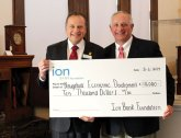 Ion Bank President and CEO Charles J. Boulier III, left, presented a $10,000 grant from the Ion Bank Foundation to Naugatuck Economic Development Corporation CEO Ronald Pugliese recently. The foundation has awarded grants totaling $123,000 to the NEDC, a public-private organization, over the past 11 years. The most recent grant will be used to help the NEDC achieve its primary goals of increasing Naugatuck's tax base and grand list, and increasing the visibility and enhancing the image of the borough and its business community, 'thus making Naugatuck a better place to do business and increasing the value of property,' Pugliese said in a press release. -CONTRIBUTED