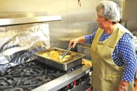 Belmira Valente fries up some fish for the Ladies Auxiliary of the Naugatuck Portuguese Club's annual Lenten fish fry March 14. The fish fry is open every Friday through April 11 at the club, 110 Rubber Ave., starting at 11:30 a.m. -CONTRIBUTED