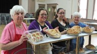 The Lenten bakery at St. Michael's Church in Naugatuck is open for the season. From left, volunteer Marion Russo of Waterbury along with church members Janet Madhazi of Waterbury Alicia Bonito of Waterbury and Judy Greisbach of Naugatuck showcase some of the homemade baked goods on sale. The Lenten bakery is open at the church, 210 Church St., every Friday through April 4 from 12 to 4 p.m. –ELIO GUGLIOTTI