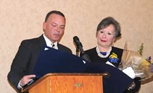 Kevin DelGobbo reads a proclamation from state legislators congratulating Donna Andrew, right, on receiving the United Way's Mary Connelly Community Caring Award during the organization's annual meeting Tuesday at The Crystal Room in Naugatuck. During the meeting, the United Way announced it reached its campaign goal of $440,000. –LUKE MARSHALL
