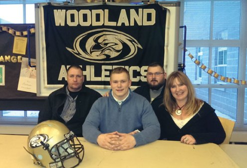 Woodland senior Levi Fancher signed his National Letter of Intent to play football at Assumption College in Worcester, Mass, March 5. Fancher set several school records at Woodland, including the career sacks mark, and helped lead the Hawks to back-to-back state tournament appearances, including a Class S final berth in 2013. He said playing college football has been his goal 'since day one freshman year' and that it 'felt like home' at Assumption, where he will go into biotechnology. Fancher was joined at the signing by his parents, Cliff and Kristen Porter, and his oldest brother, Nate.-KYLE BRENNAN