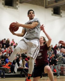 Bryan Coney hauls in a rebound during the 7th annual Clash for the Cure March 27 at Naugatuck High School. –ELIO GUGLIOTTI