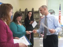 Prospect Grange officers Frances Maxwell, William Maxwell, Tina Meehan, Beatrice Meehan and Jean Meehan surprised Region 16 teachers in Prospect April 2 with certificates of recognitions as part of Grange Month celebration. Pictured, Algonquin and Community schools Assistant Principal Jeff Haddad hands certificates to teachers Beatrice Meehan, left, and Tina Meehan as Algonquin and Community schools Principal Rima McGeehan, in back, looks on. –CONTRIBUTED