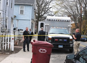 Police cordon off a home at 20 Diamond St. in Naugatuck Tuesday as they investigate the untimely death of an infant at that address. –LUKE MARSHALL
