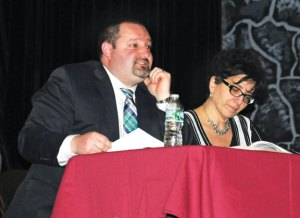 Naugatuck Assistant Superintendent of Schools Christopher Montini, left, discusses the Board of Education's 2014-15 budget proposal with the Joint Boards of Finance and Mayor and Burgesses April 7 at Naugatuck High School as Assistant Business Manager Bernice Rizk, right, looks over the budget information. –LUKE MARSHALL