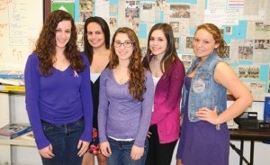 Naugatuck High School juniors, from left, Brittany Pierce, Mikayla Healy, Justine Boulanger, Courtney Leblanc and Jami Dwy were among the students who wore purple clothing or purple ribbons April 11 to show their support for world language teacher Rebecca Cruz as she battles pancreatic cancer. Students and staff are planning events to help raise awareness about the disease and funds to offset Cruz's medical bills. –LUKE MARSHALL