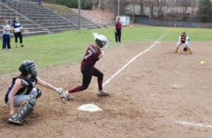 Naugatuck's Kara Klimaszewski (7) sends a single through the infield Monday versus Kennedy in Waterbury. The Greyhounds rallied in the seventh inning to claim a 5-3 win. –KEN MORSE