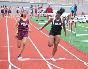 Woodland's Ashley Miche, right, edges out Naugatuck's Michaela Rossamondo to win the 25 meters April 22 at Naugatuck. The Woodland boys and girls both picked up victories over Naugatuck. –LUKE MARSHALL