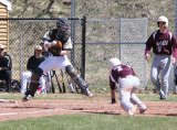 Naugatuck's Kyle Plasky (7) dives safely into home as Woodland catcher Mike Gondola tries to haul in the throw and get the out April 17 in Beacon Falls. Naugatuck's Jason Bradley (19) is looking on. The Greyhounds won the game, 6-1. –ELIO GUGLIOTTI