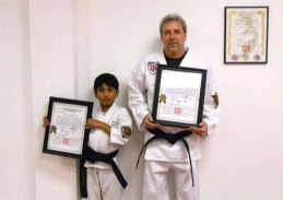 Druv Nimmagada, left, and Craig Payton achieved the rank of first degree black belt during a testing at Sokol's Taekwondo in Naugatuck Feb. 22. –CONTRIBUTED