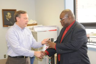 Beacon Falls First Selectman Christopher Bielik, left, presents a badge to Officer Timothy Wilson on during a swearing-in ceremony May 7 at Town Hall. Wilson, 47, of Naugatuck, is the newest officer of the Beacon Falls Police Department. He will serve as a part-time officer. Wilson brings over 30 years of experience to the department, having retired in May 2013 as a detective from the New Haven Police Department. The ceremony was attended by his Wilson's wife, Lisa Wilson, and daughter, Malena Wilson. Kenny Howell, police chief of the Millbury, Mass. Department, and Lt. Angela Augustine-Daye, both of whom served with Wilson in New Haven, also came to the ceremony. 'Wilson is an honorable man who always did the right thing,' Howell said. –LUKE MARSHALL
