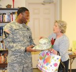 Joan Corsino, right, shows off her derby hat to Sgt. Korean Treadwell of the U.S. Army's Waterbury recruiting office during the Naugatuck Senior Center's third annual Kentucky Derby Day May 2. Aside from the 'horse race' the day featured a Kentucky Derby Dinner, informational vendors, and plenty of decorative hats. –LUKE MARSHALL