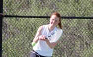 Woodland's Rachel Mariano returns a shot May 5 versus Kennedy's Brittney Caron in Beacon Falls. Mariano won the match 8-1, as the Hawks won the team match 6-1. –ELIO GUGLIOTTI
