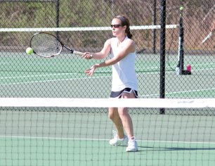 Woodland's Ally Mayne hits a forehand shot May 5 in her match versus Kennedy's Samantha Campanaro in Beacon Falls. Mayne won the match 8-1, as the Hawks won the team match 6-1.