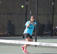 Woodland's Salma Shitia hits a backhand shot May 5 in her match versus Kennedy's Emily Toro in Beacon Falls. Shitia won the match 8-0, as the Hawks won the team match 6-1. –ELIO GUGLIOTTI