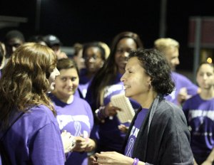 Naugatuck High School world language teacher Rebecca Cruz talks with students on the school's track June 13 during Cruz Night. –ELIO GUGLIOTTI