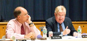 Naugatuck Interim Superintendent of Schools James Connelly, rights, gives his views on the strengths and weakness of the district during the Board of Education's June 12 meeting as school board Chairman David Heller listens. –LUKE MARSHALL