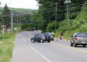 Cars turn around on New Haven Road near Hazel Avenue Friday afternoon as police have the road blocked off ahead to investigate a head-on collision. –LUKE MARSHALL